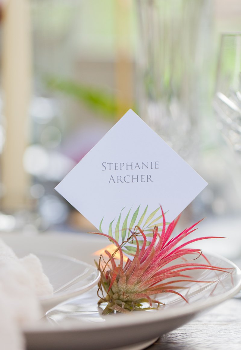 Place card on a wedding table by Flamboyant Invites